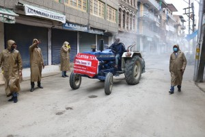 Srinagar: A team of the Srinagar Municipal Corporation carries out sanitisation drive at Srinagar's Saria Bala during the 21-day nationwide lockdown (that entered the 13th day) imposed as a precautionary measure to contain the spread of coronavirus, on Apr 6, 2020. (Photo: IANS)