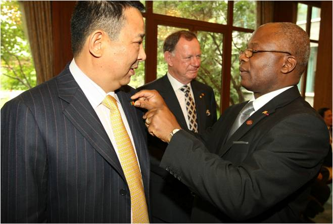 Hu is getting an honour from an African Ambassador for his services