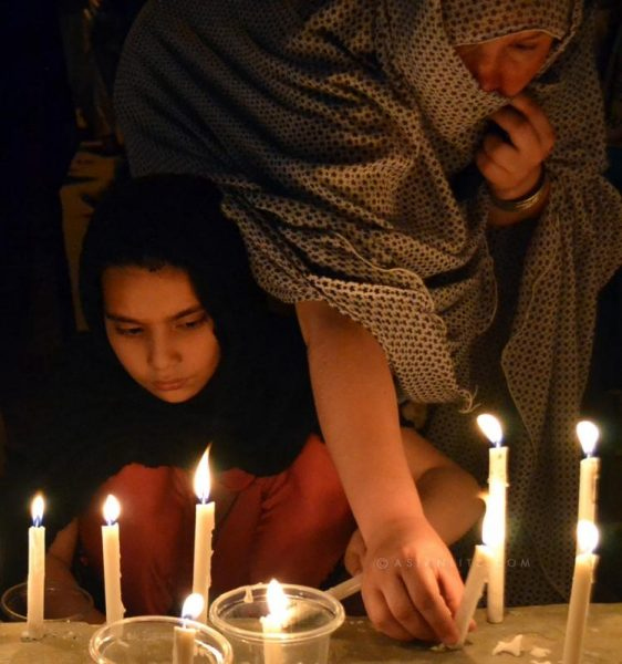 Pakistani Shiite Muslims light candles during a vigil ceremony against the killing of Shiite pilgrims in southwest Pakistan's Quetta on UN Secretary-General Ban Ki-moon on Monday strongly condemned Sunday's terrorist attacks in Pakistan, including an assault on Jinnah International Airport in Karachi which reportedly killed at least 29 people, and suicide attacks targeting Shiite pilgrims in Taftan, Baluchistan, which left at least 25 people dead and many more injured