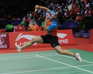 Indian badminton player Saina Nehwal in action against he Indonesian counterpart Lindaweni Fanetri during quarter-final match of Uber Cup at Siri Fort in New Delhi on May 22, 2014. Saina defeated Fanetri by 2-0. (Photo: IANS)