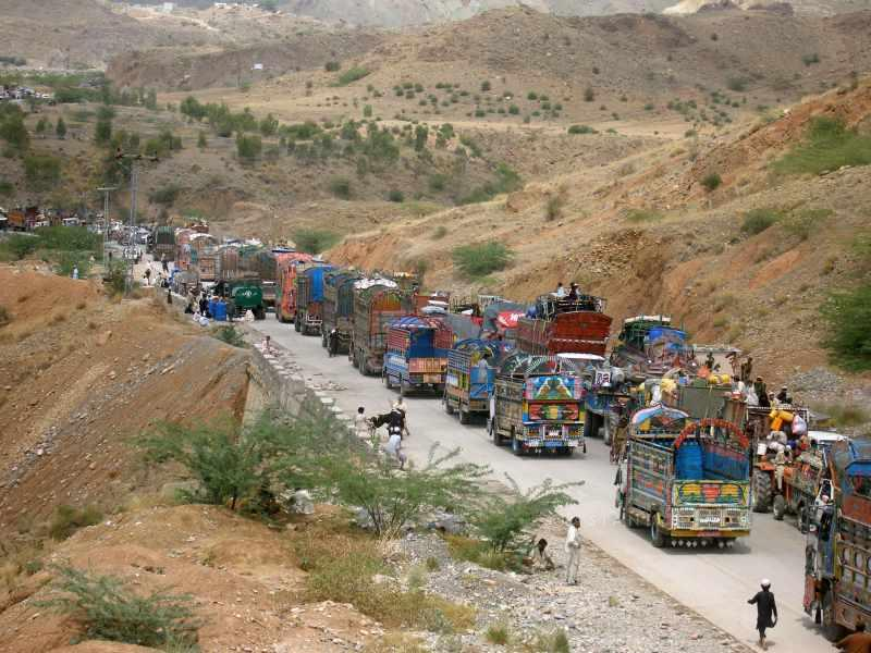 Vehicles line up at a security checkpoint as they arrive in northwest Pakistan's Bannu Civilians are streaming out of a Pakistani tribal area in a two-pronged exodus ahead of an expected ground assault against Taliban militants.