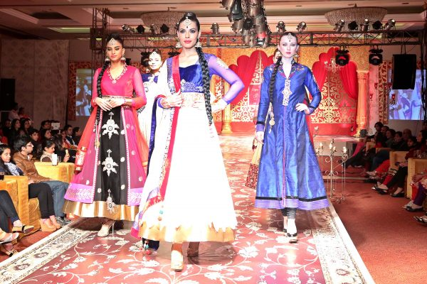 Models walk on ramp showcasing designers Kavita and Meenu's Wedding collection during a fashion show in New Delhi. (Photo: IANS)