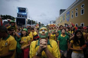 Brazilian Fans react while watching the game between Brazil and Cameroon in the FIFA Fan Fest in Recife, Brazil