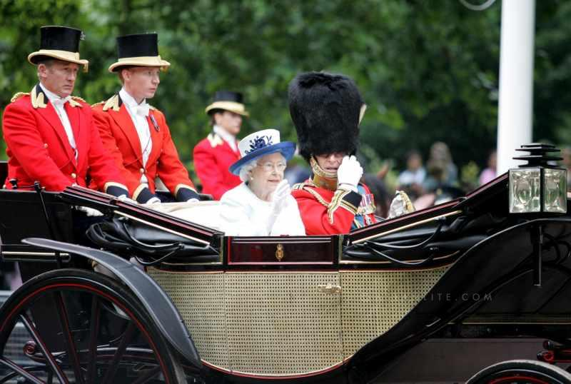 Britain's Queen Elizabeth II (L) and her husband Prince Philip attend Trooping the Colour in London on June 14, 2014. The ceremony of Trooping the Colour is to celebrate the Sovereign's official birthday.