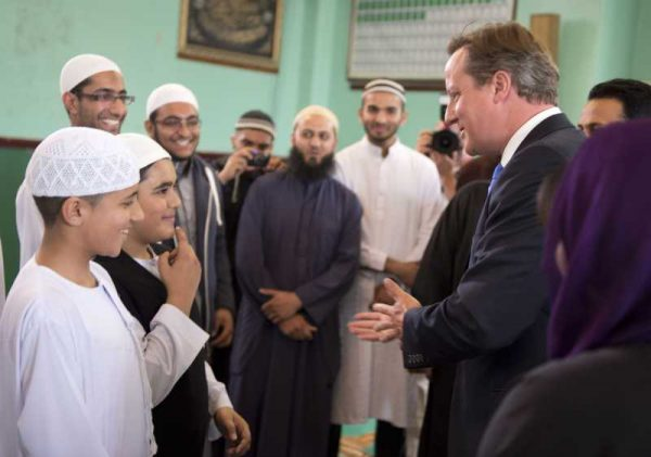 Prime Minister Cameron interacting with Muslim children during a mosque visit