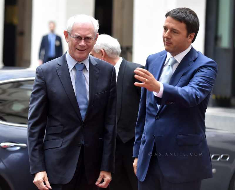 Italy's Prime Minister Matteo Renzi (R) talks with visiting European Council President Herman Van Rumpuy at the Palazzo Chigi in Rome, Italy,