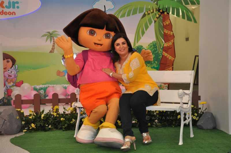 Farha Khan with a cartoon