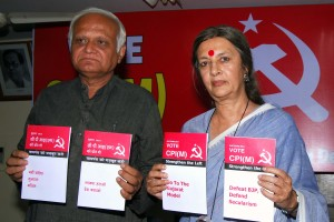 CPI-M leaders Brinda Karat and Arun Mehta release booklets against communalism in New Delhi on March 24, 2014. (Photo: IANS)