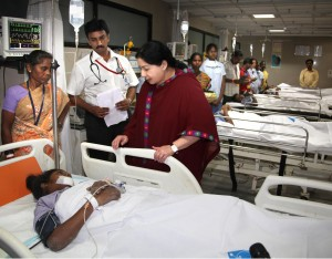 Tamil Nadu Chief Minister J Jayalalithaa meets an accident victim who got injured after a portion of a 11-storey under construction building collapsed at Moulivakkam in Chennai Saturday evening, on June 29, 2014. (Photo: IANS)