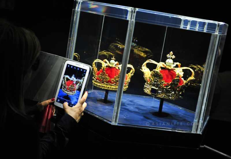 A tourist takes photos for the displaying crowns at Rosenborg Museum, in Copenhagen, capital of Denmark