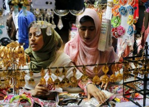 Kashmiri women busy shopping ahead of Eid ul-Fitr in Srinagar on July 27, 2014. (Photo: IANS)