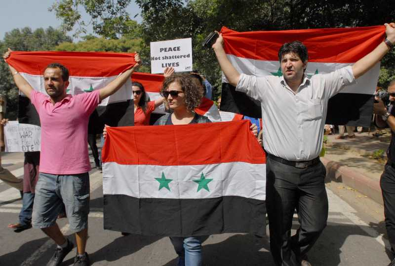 Syria - people protest against US UK