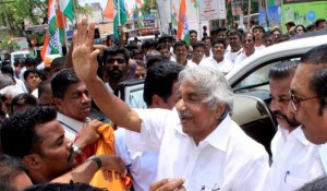 Kerala Chief Minister Oommen Chandy during an election Campaign rally supporting Congress Candidate in Coimbatore on April 19, 2014. (Photo: IANS)