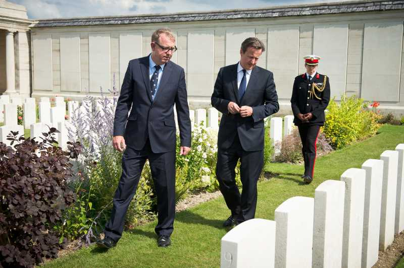 UK PM David Cameron meets with Richard Nichol from the Commonwealth War Graves Association and Harry Mount at Dud Corner Cemetery in France.