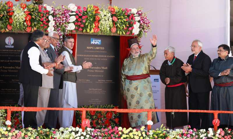 Prime Minister Narendra Modi, dressed in traditional Ladakhi gown and headgear with Jammu and Kashmir Chief Minister Omar Abdullah during inauguration of 45 megawatt Nimoo-Bazgo hydro-electric project in Leh