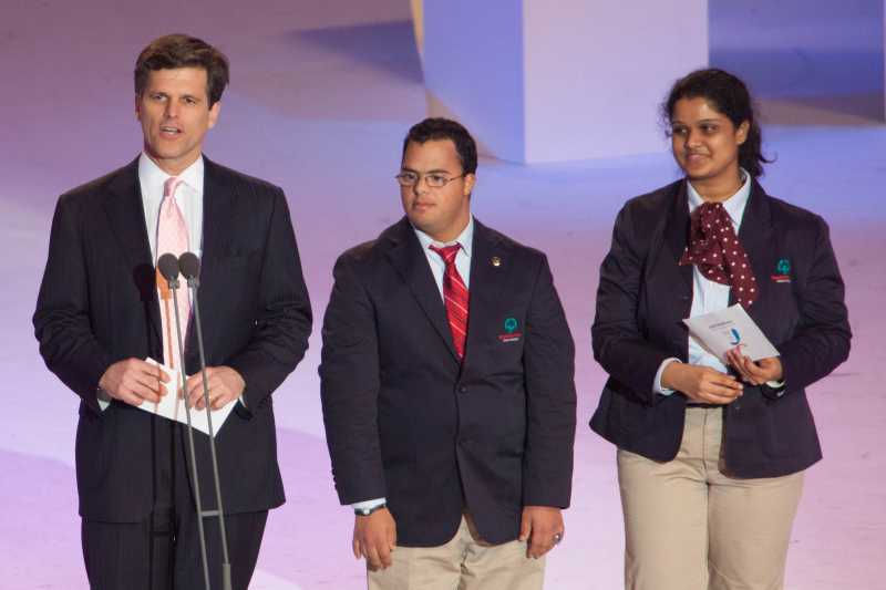Timothy P. Shriver Ph.D., left, gives his opening address with International Global Messengers Ariel Ary of Costa Rica and Neha Naik of India during the 2013 Special Olympics World Winter Games
