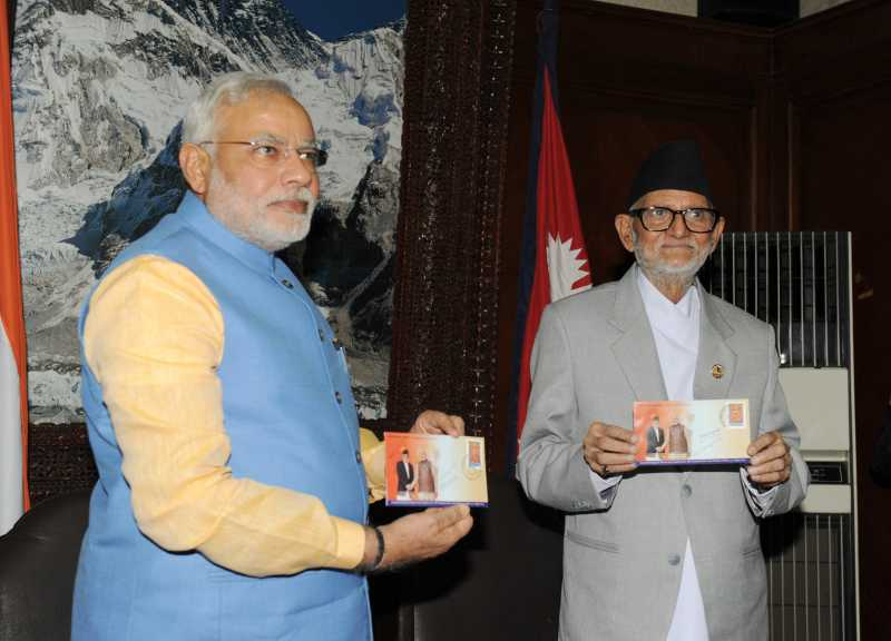 The Prime Minister, Shri Narendra Modi with the Prime Minister of Nepal, Shri Sushil Koirala releasing the commemorative of stamps, at Chambers, PMO, Singha Darbar, in Kathmandu, Nepal on August 03, 2014.
