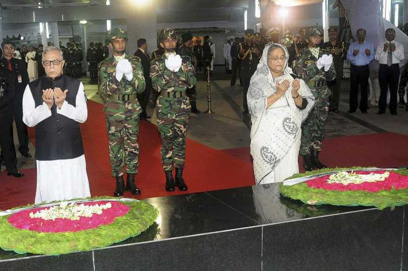 Bangladesh President Md Abdul Hamid and Bangladesh Prime Minister Sheikh Hasina lay wreaths at the mural of Bangabandhu Sheikh Mujibur Rahman at Dhanmondi 32 on the National Mourning Day, marking the death anniversary of the Bangladesh's founding father in Dhaka, Bangladesh on Aug 15, 2014. (Photo: IANS)