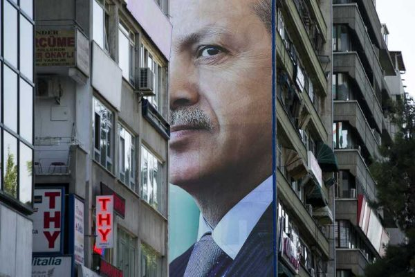 Turkey President Tayyip Erdogan's giant poster is seen hung on the exterior wall of a residential building in Ankara, capital of Turkey (File)