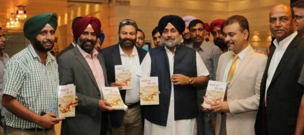 Punjab Deputy Chief Minister Sukhbir Singh Badal launches `Kabaddi Di Balle Balle` a book authored by Dr. Chahal in Chandigarh on July 25, 2014 (File)