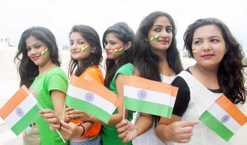 People in celebration mood on the eve of Independence Day in Bhopal on Aug 14, 2014. (Photo: IANS)