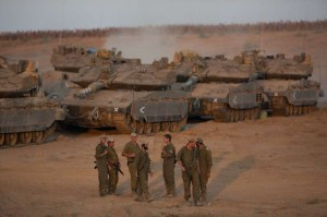 Israeli soldiers are seen at a deployment area in southern Israel bordering Gaza Strip,