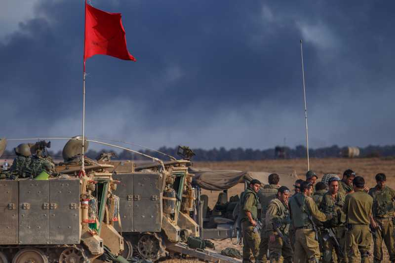 GAZA BORDER: Israeli soldiers are seen at an army deployment area in southern Israel near the border with Gaza