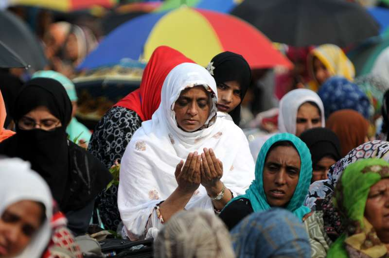 Pakistani supporters of religious leader Tahir-ul-Qadri participate in Friday prayers held at an anti-government protest site in front of Parliament in Islamabad capital of Pakistan