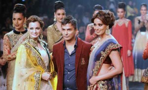 Showstoppers Dia Mirza and Bipasha Basu with designer Vikram Phadnis during his show at Lakme Fashion Week (LFW) Winter/ Festive 2014, in Mumbai, on Aug. 23, 2014. (Photo: IANS)