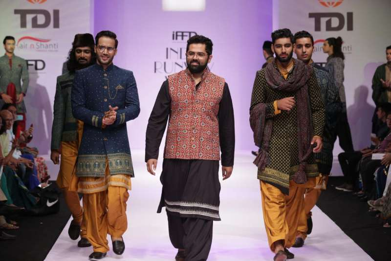 Models walks the ramp during Day 2 of the India Runway Fashion Week in New Delhi on Sept. 20, 2014. (Photo: IANS)