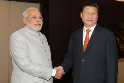 Prime Minister Narendra Modi during a meeting with President of the People's Republic of China Xi Jinping on the sidelines of 6th BRICS Summit in Fortaliza, Brazil on July 14, 2014. Modi called for amicably resolving the boundary row with China and sought enhanced investment in India's infrastructure sector during the meeting. (Photo: IANS)