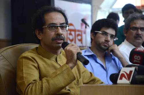 Shiv Sena chief Uddhav Thackeray and Yuva Sena chief Aditya Thackeray during a programme at Shiv Sena Bhawan in Mumbai on Sept 7, 2014. (Photo: Sandeep Mahankal/IANS)