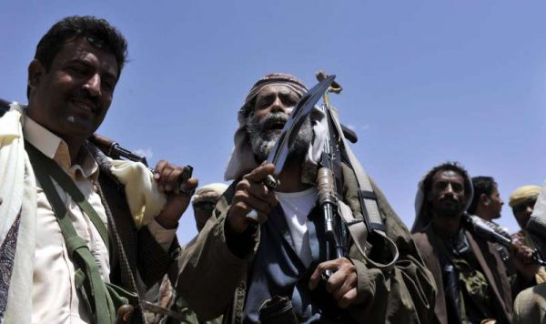 Fighters loyal to the Shiite Houthi group gather at a camp outside Sanaa, Yemen. Yemeni President Abd-Rabbu Mansour Hadi will replace the government and called for a national unity administration, in a move to calm down the recent spate of protests, the official Saba news agency reported Tuesday.