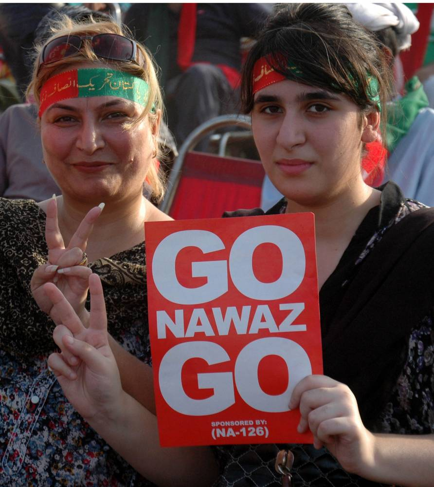 Supporters of opposition leader Imran Khan gathered at an anti-government protest in eastern Pakistan's Lahore . Supporters of Pakistan's two opposition leaders, Imran Khan of Pakistan Tehrik-e-Insaf and Tahir ul Qadri of Pakistan Wami Tehrik attended the sit-in protest in Islamabad, demanding resignation of Prime Minister Nawaz Sharif and fresh polls.