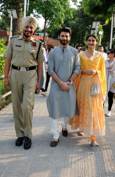 Actors Fawad Khan and Sonam Kapoor with BSF personnel during a promotional event of their upcoming film Khoobsurat at Attari international border on Sept. 17, 2014. (Photo: IANS)