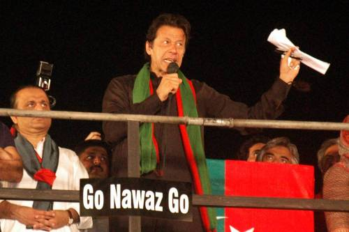 Pakistani opposition leader Imran Khan addresses his supporters at an anti-government protest in eastern Pakistan's Lahore on Sept. 28, 2014. Supporters of Pakistan's two opposition leaders, Imran Khan of Pakistan Tehrik-e-Insaf and Tahir ul Qadri of Pakistan Wami Tehrik attended the sit-in protest in Islamabad, demanding resignation of Prime Minister Nawaz Sharif and fresh polls. FILE PHOTO
