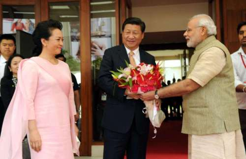 Prime Minister Narendra Modi greets Chinese President Xi Jinping, on his arrival in Ahmedabad, Gujarat