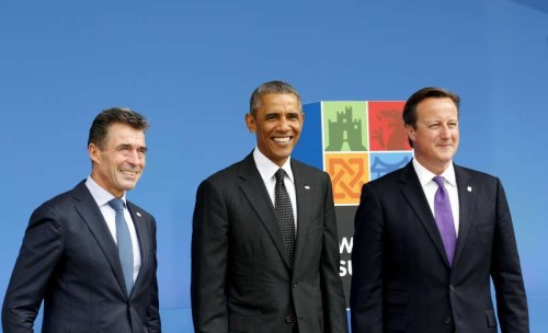 The NATO Secretary General Anders Fogh Rasmussen (L), U.S. President Barack Obama (C) and British Prime Minister David Cameron pose at the NATO Summit 2014 in Newport, Wales, the United Kingdom, Sept. 4, 2014. The two-day NATO Summit 2014 kicked off in Wales