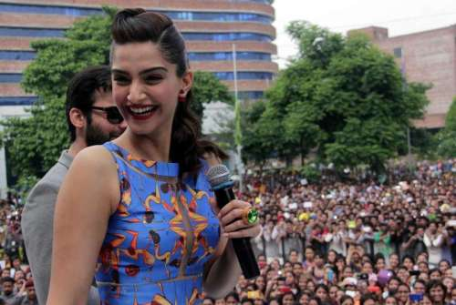 Actors Fawad Khan and Sonam Kapoor during a promotional event of their upcoming film Khoobsurat at a private university in Jalandhar, on Sept. 18, 2014. (Photo: IANS)