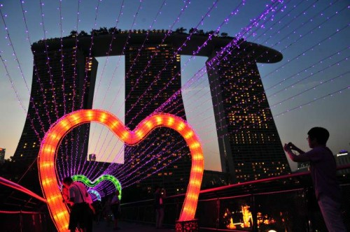 Visitors view lanterns for the upcoming Mid-Autumn Festival in Singapore. A light-up ceremony is held here before the festival.