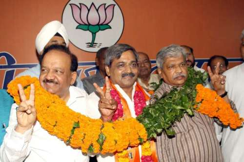 Union Health Minister and former Delhi BJP chief Harsh Vardhan hands over the charge to newly appointed Delhi BJP chief Satish Upadhyay during a programme at BJP office in New Delhi