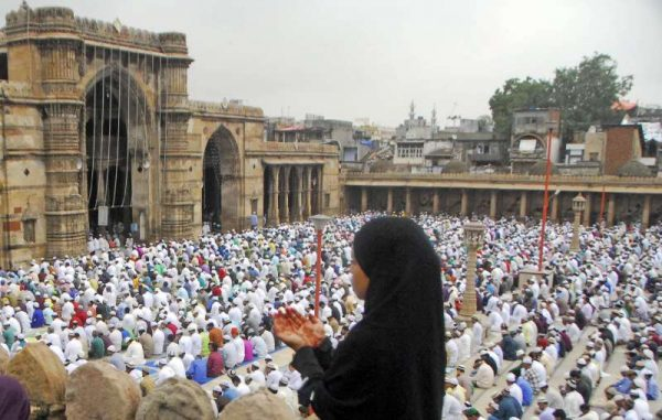 Muslims offer prayers on the occasion of Eid ul-Fitr at a mosque in Ahmedabad on July 29, 2014. (Photo: IANS)