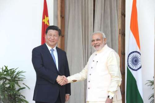 Prime Minister Narendra Modi shaking hands with the Chinese President Xi Jinping at Hyderabad House in New Delhi