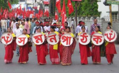 Communist Party of India-Marxist (CPI-M) workers during a rally in Siliguri on April 14, 2014. (Photo: IANS)