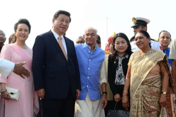 (L-R) First Lady of the Republic of China, Peng Liyuan, Chinese President Xi Jinping, Gujarat Governor O.P. Kohli and Gujarat Chief Minister Anandiben Patel (R) at Sardar Patel International Airport in Ahmedabad, Gujarat on Sept 17, 2014. (Photo: IANS)