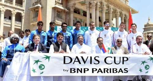 Karnataka Chief Minister Siddaramaiah with Indian tennis coach Vijay Amritraj, Indian tennis players Somdev Devvarman, Rohan Bopanna, Leander Paes, Yuki Bhambri and others during the draw ceremony of Davis Cup - 2014 at the Vidhan Soudha in Bangalore