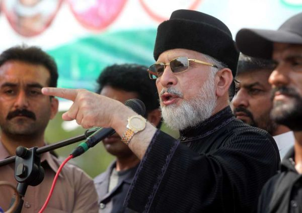 "Pakistani religious leader Tahir-ul-Qadri speaks during an anti-government protest site in front of Parliament in Islamabad, capital of Pakistan on Sept. 19, 2014. Pakistani Prime Minister Nawaz Sharif on Friday accused two protesting parties of ""inciting people to opt for munity"" but made it clear that few thousands people would never succeed in their ""sinister designs"" to derail the system."