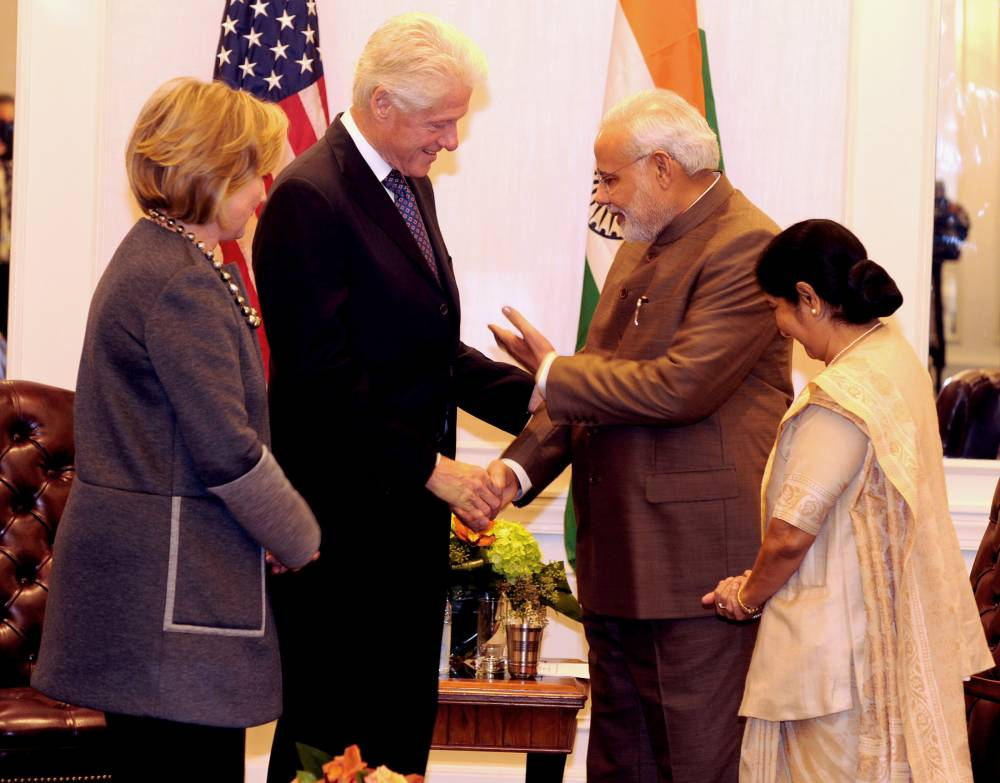 The Prime Minister, Shri Narendra Modi meeting the former US President, Mr. Bill Clinton and former US Secretary of State, Mrs. Hillary Clinton, in New York on September 29, 2014. The Union Minister for External Affairs and Overseas Indian Affairs, Smt. Sushma Swaraj is also seen.