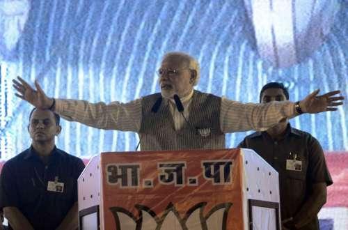 Prime Minister Narendra Modi addresses a BJP rally in Borivali of Mumbai on Oct.12, 2014. (Photo: Sandeep Mahankal/IANS)