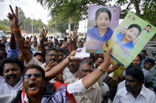 Supporters of AIADMK supremo and former Tamil Nadu Chief Minister J Jayalalithaa gather at Karnataka High Court during a hearing of the Rs.66-crore disproportionate assets case against their leader in Bangalore. File Photo